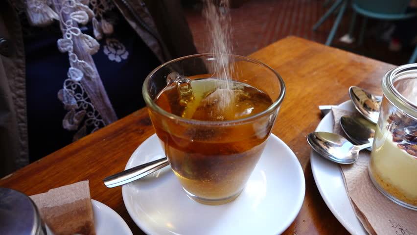 Tea in cafe. Slow motion. | Shutterstock HD Video #1011665798