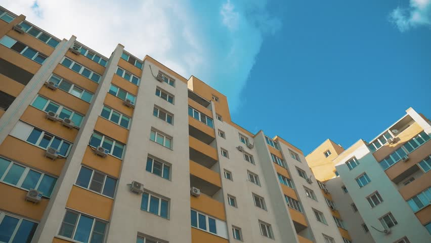 multi-storey house lifestyle with air conditioning against the blue sky . concept city life
