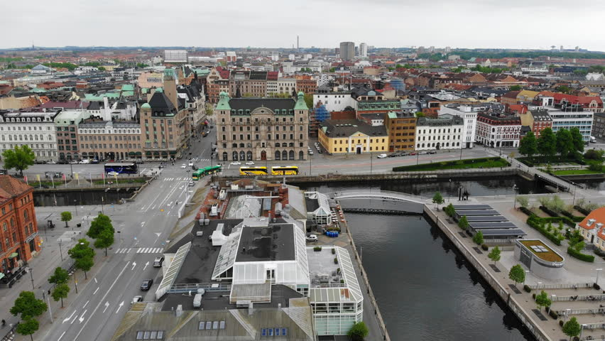 Aerial view of cityscape of Malmo, capital city of Scania, city canals, mixture of historic and modern architecture - landscape of Sweden from above, Scandinavia, Europe, 4k UHD | Shutterstock HD Video #1011704468