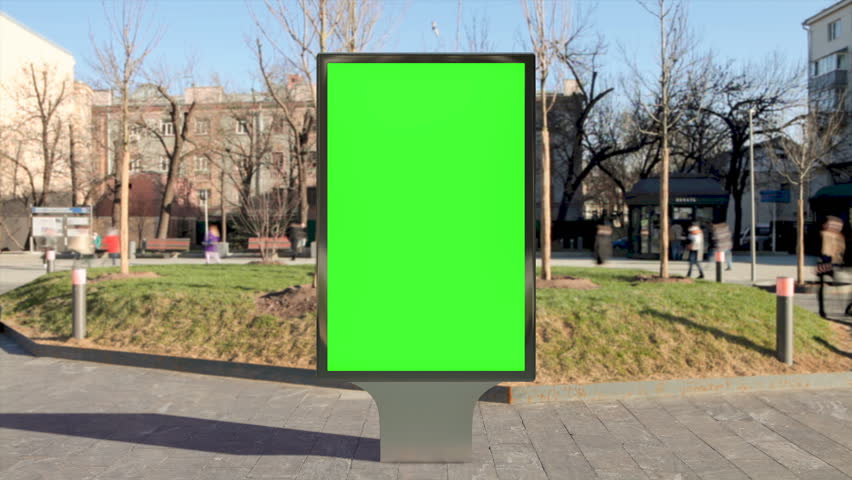 Street billboard stand with green screen on pavement. Time lapse seamless loop.