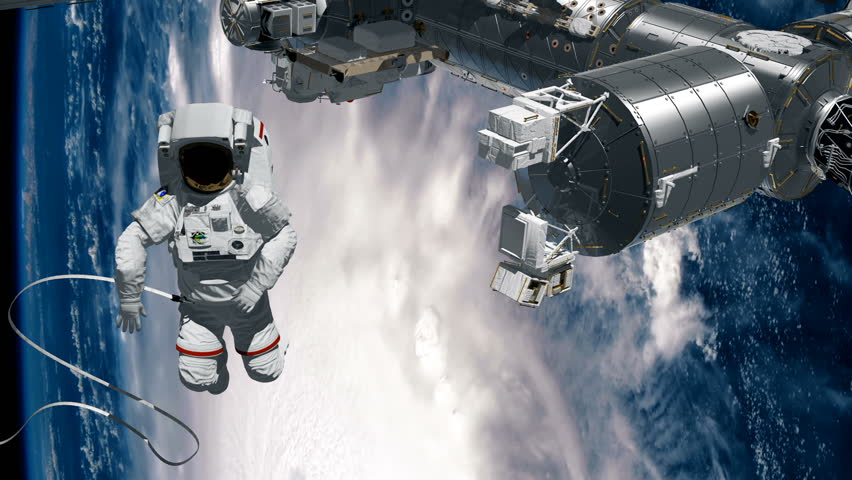 Astronaut Spacewalk, waving his hand in the open space. International Space Station ISS revolving over earths atmosphere. Hurricane behind.