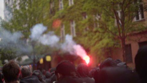 GERMANY - CIRCA MAY 2017 - Black bloc anti capitalism antifa protests, red flare, flash bang, Berlin