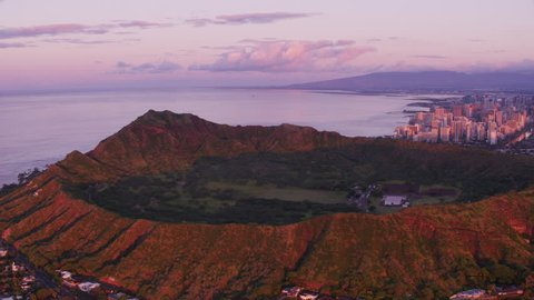 Honolulu, Oahu, Hawaii circa-2018. Aerial view of Diamond Head Crater and Waikiki at sunset. Shot with Cineflex and RED Epic-W Helium.