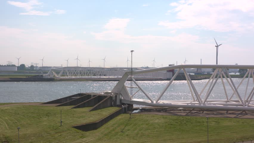 Two doors of the opened Maeslantkering or Maeslant Storm Surge Barrier, part of the Europoort Barrier of the Dutch Delta Plan, well protected in drydock ashore.