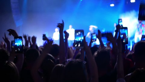 Concert live streaming mobile phone hand