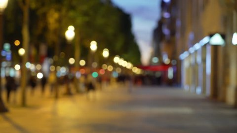 Defocused night scene on the Champs-Elysees in Paris France. Bokeh background plate of French urban setting at night