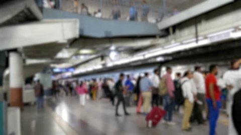 Blurred, Passengers board the train at underground metro subway station platform, Delhi Metro Airport Express Train, New Delhi, India