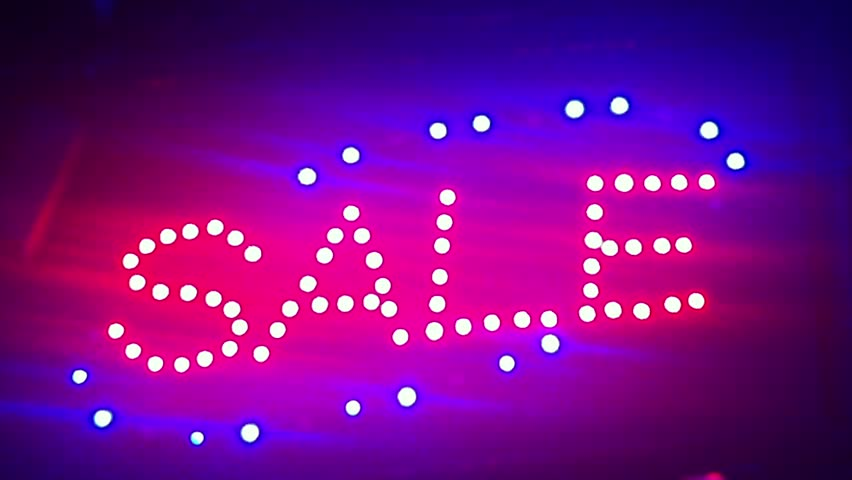 Illumination Sale. Street sign with small lights, garlands. Scenery with glowing, flashing lights. Dynamic, motion footage. Holiday movie.  #1011827408