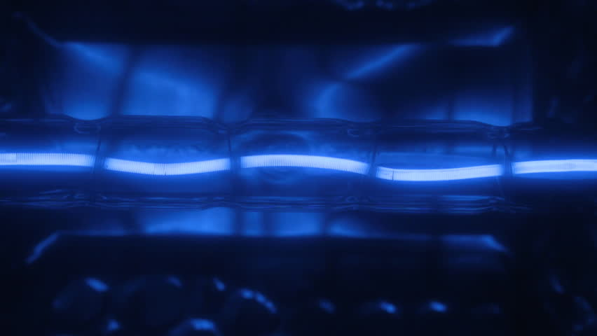 Flicker of a blue tungsten spiral of a halogen bulb. | Shutterstock HD Video #1011836498