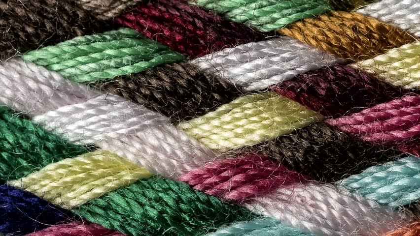 Left to right sliding  on a multicolored cotton fabric macro close up