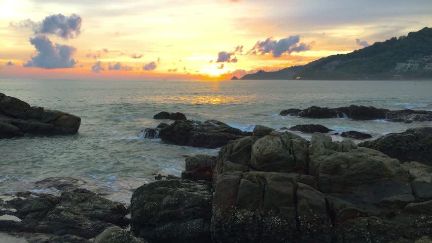 4k UHD Sunset Over Sea waves hit the shore rocks. | Shutterstock HD Video #1011859538