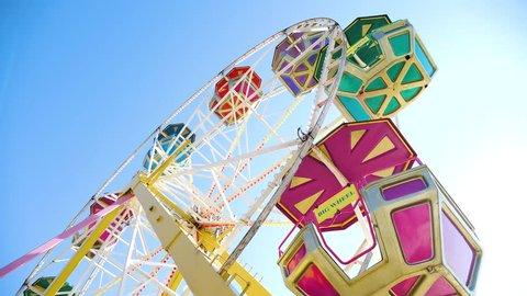 Ferris wheel on blue sky background. Video 4k