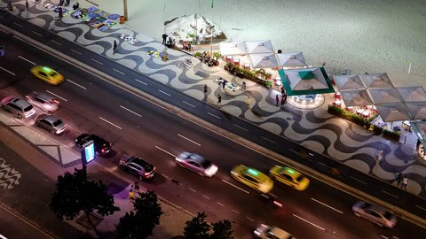 Time Lapse Of Night Traffic On Copacabana beach next to the kiosks, Rio de Janeiro, Brazil