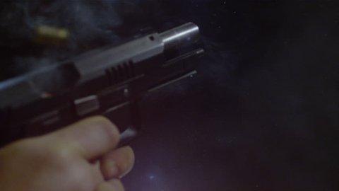 Close up of an automatic gun firing