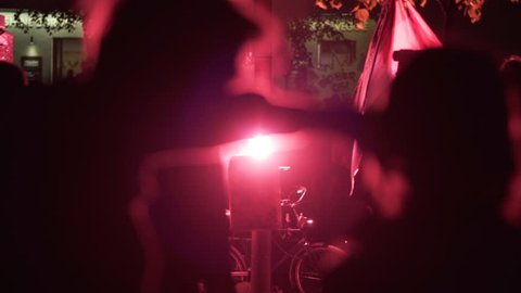 GERMANY - CIRCA MAY 2017 - Red firework flare lights street, riot police march, labor day protests, Berlin