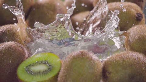 Kiwi falling in water with splash between kiwis. Slow motion 480 fps. Sony rx10 4 camera
