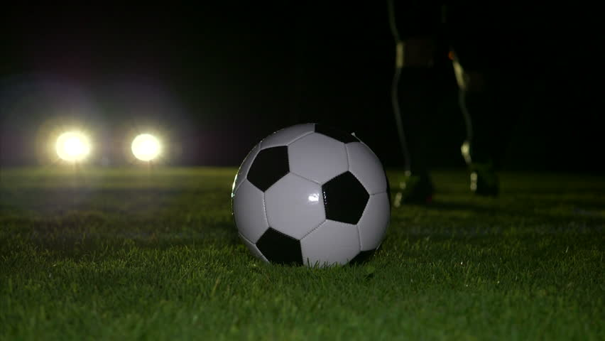 Soccer player training on football field at night. Soccer Ball Kick Off | Shutterstock HD Video #1012021718