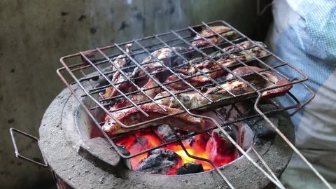 Grilled meat on charcoal grilled traditional Thai food.