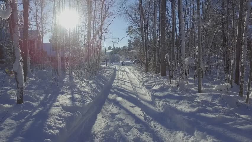 Winter Wonderland in Sweden - drone view from above on an extra snowy day. Drone flight in the forrest