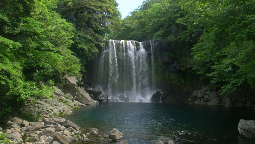 Cheonjeyeon Waterfall on Jeju Island, South Korea | Shutterstock HD Video #1012079078