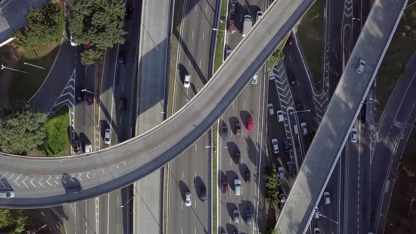 """4K UHD """"Zoom"""" Out Aerial Shot of Cars Driving on Freeway, Highway and Viaducts in São Paulo, Brazil 