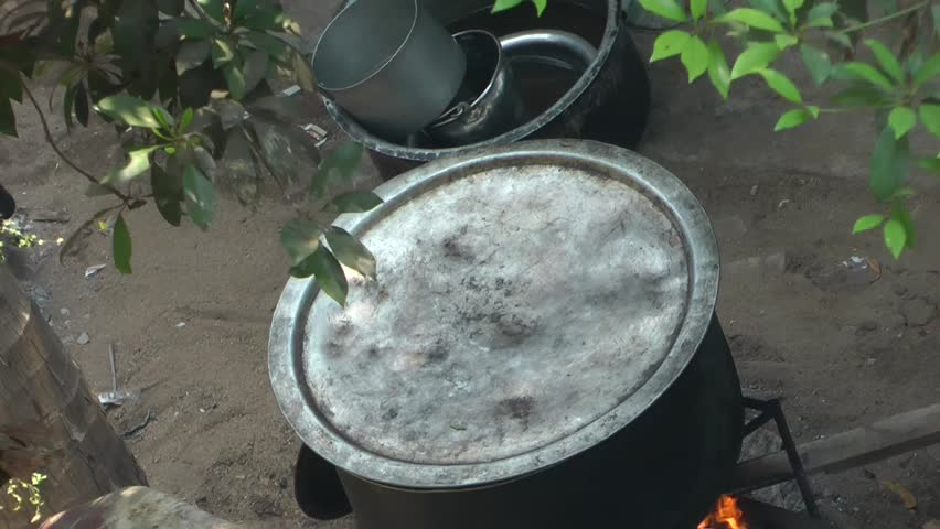 Food and Drink Time Lapse Video Footage: Tastily Indian Mutton Biryani Cooking On Wooden Stove #1012119068
