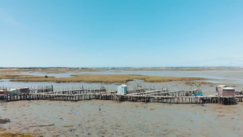 Aerial profile view of the Carrasqueira harbour in Comporta, Portugal.