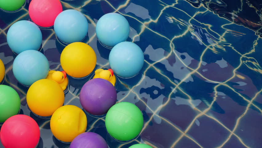 Colorful ball floating on blue swimming pool | Shutterstock HD Video #1012156688