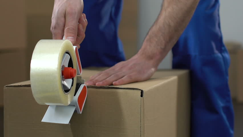 Moving service worker packing and taking out box, relocation services, migration | Shutterstock HD Video #1012237958
