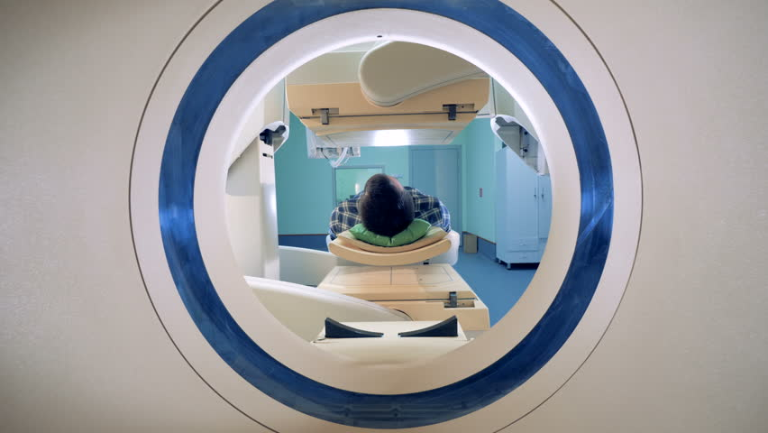 Patient lying in a tomograph. Medical equipment: computed tomography machine in diagnostic clinic | Shutterstock HD Video #1012249868