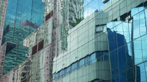 sunny day shenzhen city downtown buildings front sky reflection slow motion 4k china