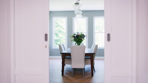 Sliding doors opening onto furnished domestic dining room