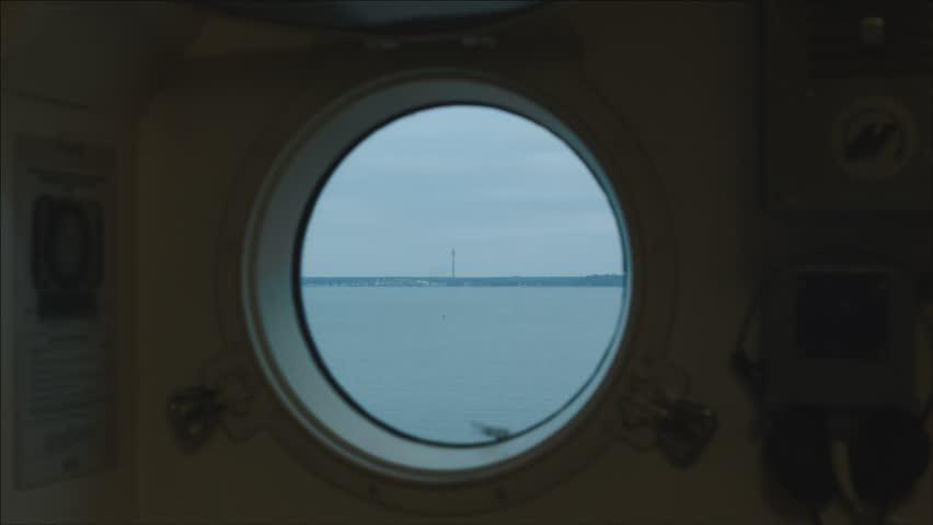 Porthole in the ship's cabin. Seaplane Harbour in Tallinn