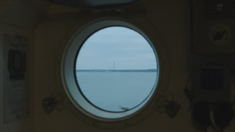 Porthole in the ship's cabin. Seaplane Harbour in Tallinn