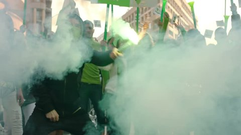 Protesters or soccer fans screaming, jumping and celebrating with smoke bomb . Shot on ARRI ALEXA in slow motion .