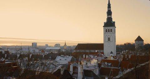 Tallinn, Estonia, Europe. Old Town Cityscape In Morning Sunrise. Popular Place With Famous Landmarks. UNESCO. Pan Panorama.