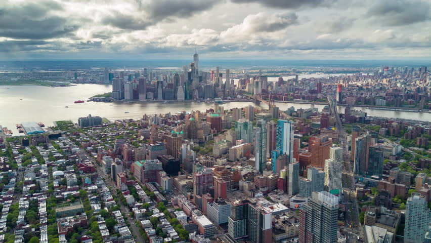 Aerial view of Brooklyn and Manhattan, New York City. Tall buildings. Sunny day, aerial timelapse. Clouds on background. | Shutterstock HD Video #1012402208