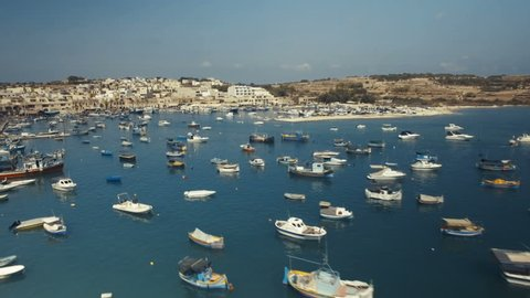 Aerial shot over moored fishing boats in Marsaxlokk