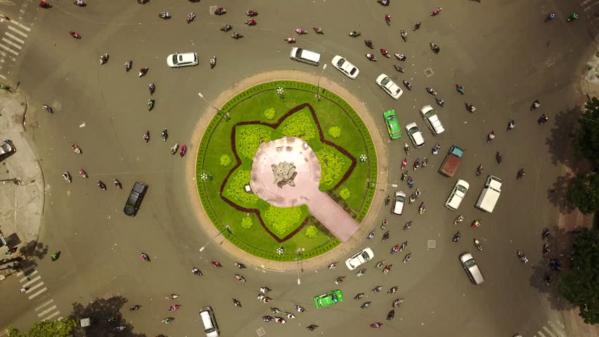 Aerial Drone - Time Lapse of Busy Traffic Circle - Ho Chi Minh City - Vietnam | Shutterstock HD Video #1012408538