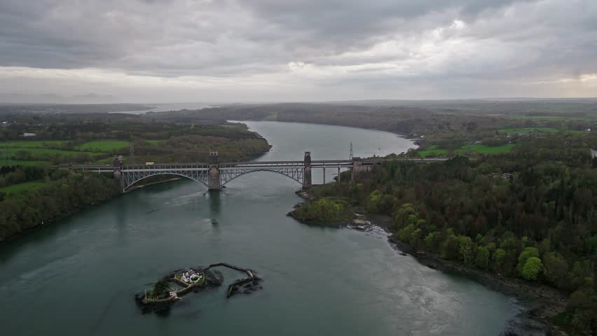 ANGLESEY , WALES - APRIL 26 2018 : Robert Stephenson Britannia Bridge carries road and railway across the Menai Straits between, Snowdonia and Anglesey , Wales