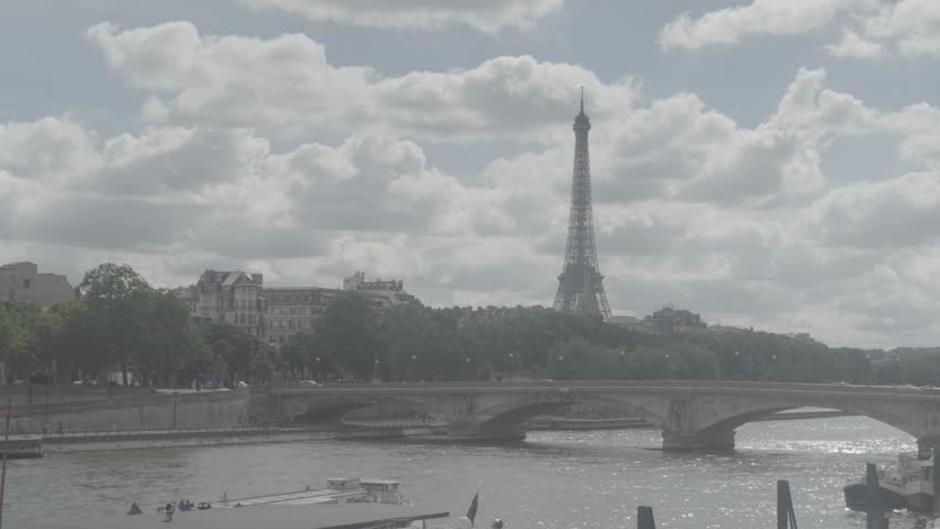 Paris, France - June 7, 2018: View of Eifel tower, American Church in Paris, Invalides Bridge, pleasure boat on the Seine | Shutterstock HD Video #1012420328
