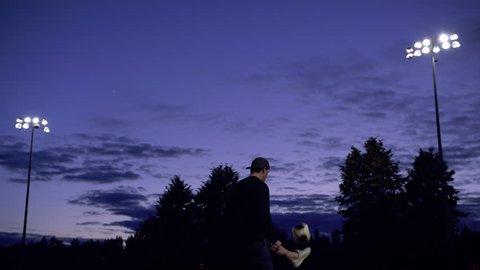 Man Juggling Soccer Ball Header at Night