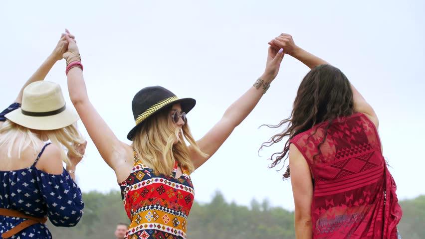 Hipster friends dancing among confetti outside | Shutterstock HD Video #1012445948