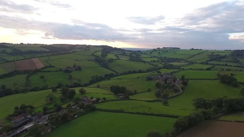 Aerial drone footage of rolling hills of the English countryside at sunset. Just outside of the historic city of Bath in Somerset.