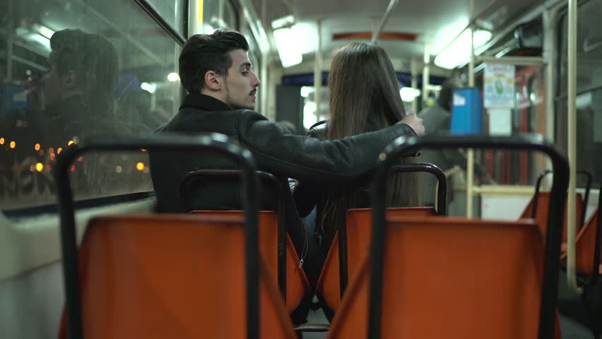 Rear view of a couple sitting in a tram. | Shutterstock HD Video #1012464548