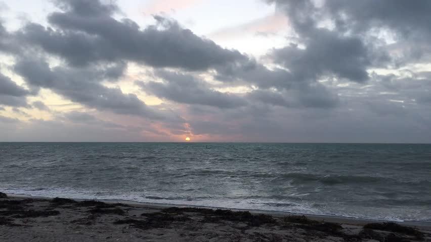 Sunrise over the Atlantic ocean in Historic Virginia Key Beach Park near Miami, FL