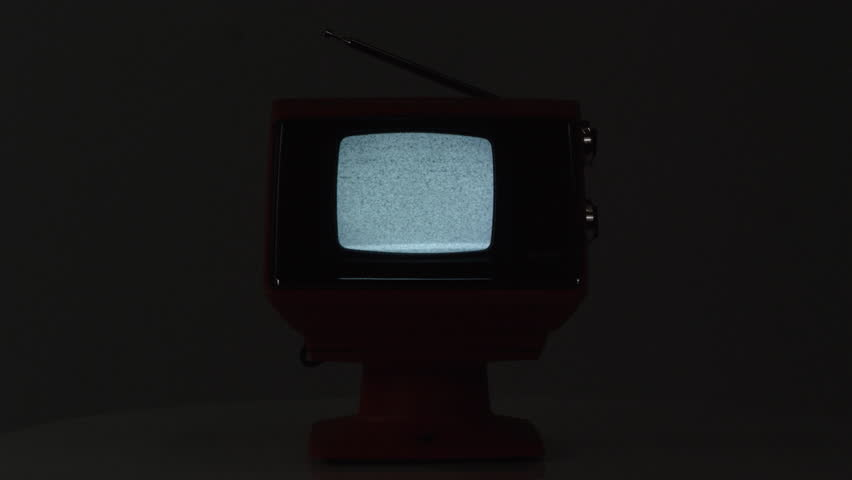Small old TV playing static in the dark as TV turns off. | Shutterstock HD Video #1012479908