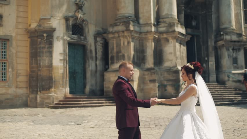 Lovely wedding couple standing together in the city. Few shots | Shutterstock HD Video #1012519028