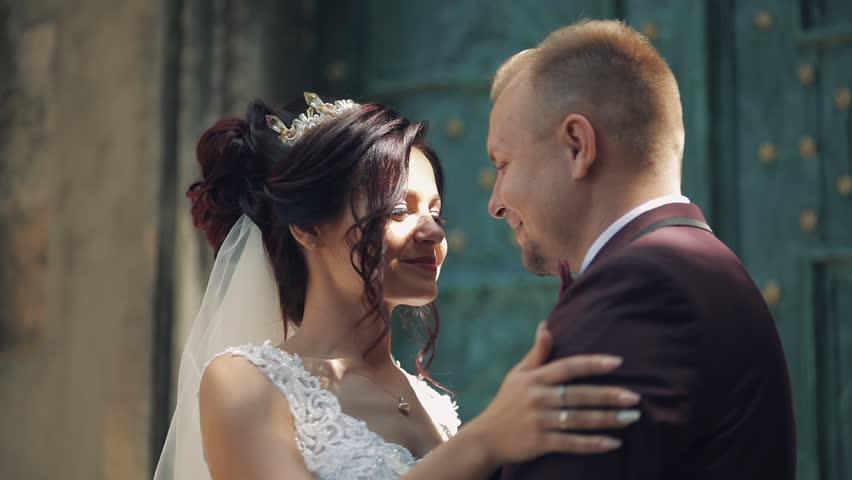 Lovely wedding couple making a kiss | Shutterstock HD Video #1012519088