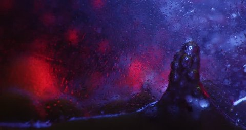 Color drops floating in oil and water over a colorful underground with oil painting effect. Shot on RED. 4K.